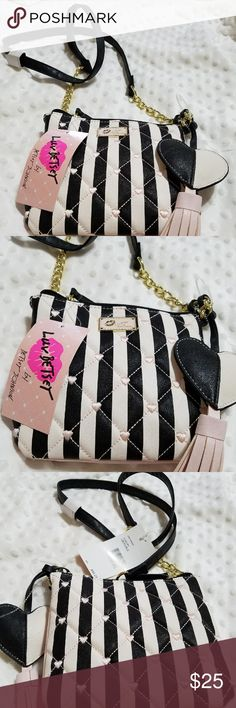 BRAND NEW!!  Betsy Johnson purse Black and white in color. With two gold chains on each strap small hearts. Size is 6.5*7 inches betsy johnson Bags Laptop Bags