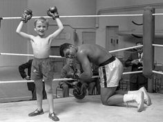Muhammad Ali letting a young fan win a fight, 1963