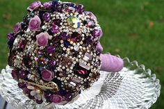 This will be the inspiration bouquet for Julie to create hers. Looking at her collection of things she would like for her wedding, I noticed that she really liked brooch bouquets, so I sought out one that would match her colors. This sparkling plum purple creation is the perfect inspiration bouquet. I will also have her maids carry brooch bouquets, but on a much smaller scale than Julie's so that she can be the center of attention on her special day.
