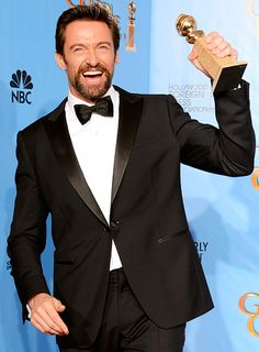 Hugh Jackman waved his Golden Globe (for Best Actor in a Comedy or Musical) backstage at the Beverly Hilton Jan. 13.