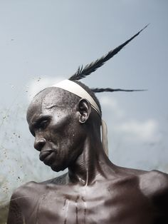 In the Mursi tribe, feathers are only allowed to be worn on the head by respected elders or celebrated warriors.© JOEY L