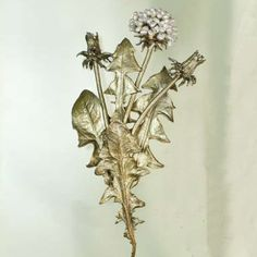 The Dandelion Brooch Pin by Michael Michaud features bronze leaves and stems with freshwater pearl dandelion flowers. Michael Michaud Jewelry is handcrafted in New York City.