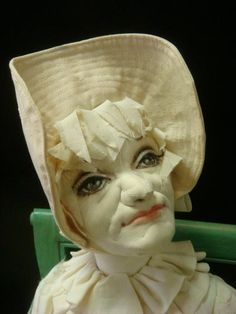 Soft Art Sculpture Doll by DAVID STRAUS: Caricature Doll, Hand painted, Seated w/Folded Hands On Vintage Cane Seat Arm Chair, Signed on Sleeve. Consider- One of America's Outstanding Artists. Originally Sold for Over $1,000. Minor Damage to Lace. (500-700)