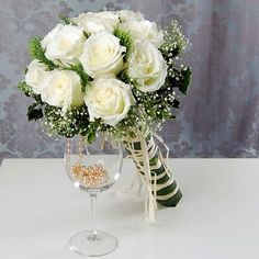 Extensive lists of Wedding Bouquets and Wedding Flowers to choose from. Comes with Roses, Silk Bridal Bouquets and many other types of Wedding Flowers Wedding Flower Pictures, Budget Wedding Flowers, Wedding Flower Design, Winter Wedding Flowers, White Wedding Bouquets, Wedding Flower Arrangements, Burgundy Wedding, Spring Wedding, Floral Arrangements