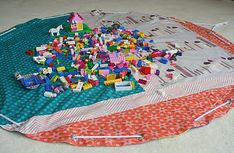 Lego Storage Bag - lay out flat to use as a play mat, then pull drawstring closed and all legos are stored away.