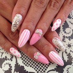 girly pink and white stiletto with strips and polkadots with jewels nail art design