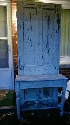Upcycled door as a Hall tree/ entry table. by ReclamationNation