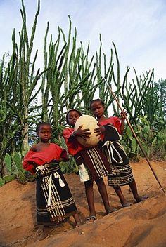 Antadroy children with ostrich egg, Magadascar, Africa