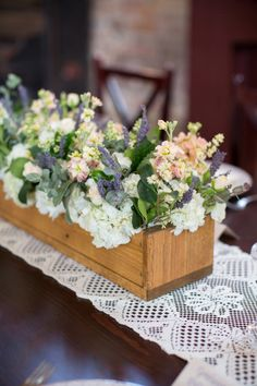 Beautiful flowers, like the wooden box.