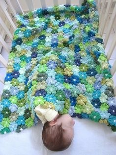 crochet baby blanket. How cute! Crochet flowers and sew them together. I wonder if I could crochet them together at the end of each petal as I go rather than having to sew together at the end? | best stuff