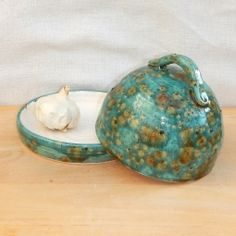 This garlic keeper can also moonlight as a large butterdish ....or even a small cheese dish.