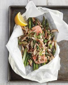 By baking the salmon and vegetables in parchment paper, you're steaming them in their own juices. This preserves nutrients, requires little added fat, and makes for a delicious entree. (Baking Salmon In Parchment Paper) Healthy Salmon Recipes, Fish Recipes, Seafood Recipes, Cooking Recipes, Healthy Dinners, Recipies, Baked Fish, Baked Salmon, Carnivore