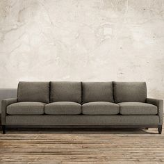 """Handcrafted in America, the Arhaus Dante 102"""" Upholstered Sofa in Wilson Graphite is fitted in a dramatic menswear woven diamond pattern fabric."""