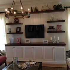 I like the idea of shelves around the tv for display.  Don't like white and dark brown colour scheme though.