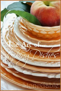 THE ART OF STACKING DISHES-- Stack is 3 dishes or more with interesting edges, can alternate dish color, anchor stack with pretty placemats, table runners or just a napkin, next add something special to top of stack (don't have to be expensive and can be napkin with napkin ring) You also can stack cups or bowls, cake stands make interesting stacks.