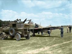 Groundcrew refuelling a Hawker Hurricane Mk. I of Nº 501 Squadron RAF from an Albion AM 463 petrol bowser at Betheniville, France.  May 1940