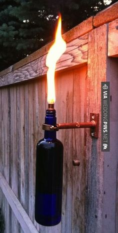 Sweet! - Wine Bottle Torches   CHECK OUT MORE GREAT RED WEDDING IDEAS AT WEDDINGPINS.NET   #weddings #wedding #red #redwedding #thecolorred #events #forweddings #ilovered #purple #fire #bright #hot #love #romance #valentines