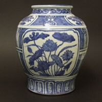 MING PORCELAIN. A Late Ming Blue and White Porcelain Kraakware Jar, Late Wanli or Tianqi c.1600-1630. The Substantially Potted Porcelain Jar is Painted with Large Panels of Flowers Including One of Lotus and Two of Peony. The Panels are Set Against Diaper backgrounds and Linked by Strap Type Ornamentation. There are Further Small Panels of Peony and the use of Ruyi-Heads.