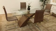 We love the look of this dining room set with the sleek lines, addition of wood and glass textures! $579.00