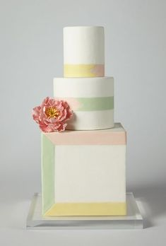 Brides: America's Prettiest Wedding Cakes   An Ivory Wedding Cake with Pastel Stripes   Cake by Wild Orchid Baking