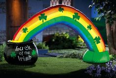 """Pot Of Gold W/ Rainbow Lighted St. Patrick's Day Inflatable By Collections Etc by Natures Touch. $27.99. Features a leprechaun's pot o gold at one end. Cord for plugging in to an AC outlet. Measures 69""""W x 38""""H. Includes self-inflating pump with metal stakes for grounding. Inflatable front yard outdoor rainbow. Invite your friends and neighbors to join your St. Patrick s Day celebration somewhere over the rainbow. Inflatable front yard rainbow features a leprechaun s..."""