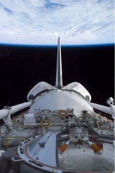 The space shuttle Discovery's cargo bay over Earth's horizon was photographed by one of the seven STS-114 crewmembers as the shuttle approached the International Space Station.