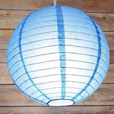 Dark blue paper lantern with lights on! Use this for any patriotic themed party and gathering. Now that memorial day is approaching, this is a perfect decoration as well as lighting solution! Go America!