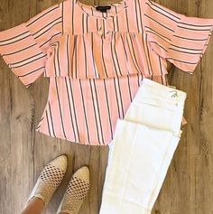 PINK continues to be a huge color for this season. The flounce makes it a fun flirty top for any date night!
