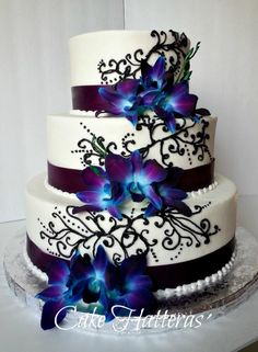 White cake with purple flowers there is a lot i like about this jessica and ryan mightylinksfo