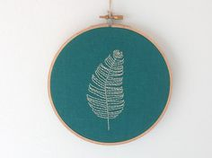 Lone Feather Hoop Art in Teal, Modern Embroidery Wall Art, Custom Made-to-Order Embroidery On Clothes, Modern Embroidery, Embroidery Hoop Art, Cross Stitch Embroidery, Embroidery Patterns, Stitch Patterns, Art Pariétal, Hand Embroidery Projects, Yarn Crafts