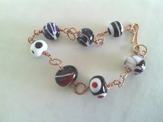 Creazioni e manufatti di Aldina: Bracciale in rame e perle al lume di mia creazione.