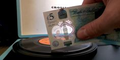 """the-future-now: """" People Are Using Britain's New Plastic Money to Play Vinyl Records """" The new plastic polymer notes are bonkers. They can't be crumpled, are extremely hard (though not impossible). Record Player Needles, Popular Mechanics, Being Used, Vinyl Records, Britain, Musicals, England, Notes, Shit Happens"""