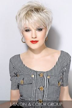 Add a little rock 'n' roll vibe to your short hairstyle with a white-hot hue and ample texture throughout the crown.