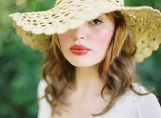 I need to get a floppy hat--and embrace my big lips. She looks beautiful.