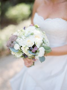 Purple and Ivory bouquet by grassrootssantabarbara.com | Read More: http://www.stylemepretty.com/california-weddings/2014/07/11/al-fresco-wedding-in-santa-barbara/ | Photography: Michael & Anna Costa Photography ~ Anna Costa - michaelandannacosta.com