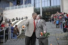 Brad and Jay McCanta kiss to a cheering crowd after getting married at Seattle City Hall. Washington made history in November as one of three US states where marriage rights were extended to same-sex couples by popular vote. Marriage Rights, Seattle City, U.s. States, News Today, Wedding Bells, Getting Married, Gay, Crowd, History