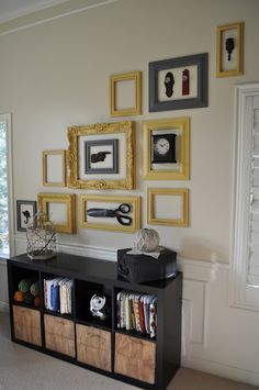 "framed objects wall - This is very similar to my girls room! Except I used more variety in texture and color. Some frames have pics, some ""frame"" objects, and some are empty."