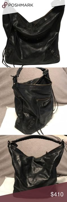 """Balenciaga """"The Day"""" leather Hobo Bag Balenciaga Brand New Black Creased Leather Day Shoulderbag - Gorgeous aged leather in classic black with a tubular carry strap with suede lace detail. Great for everyday with spacious capacity for all of life's essentials.    Black grain leather body with a black cotton lining Brass hardware Zipped outer pocket for easy access Main compartment also zipped for security Inside pocket for valuables Balenciaga Bags Hobos"""