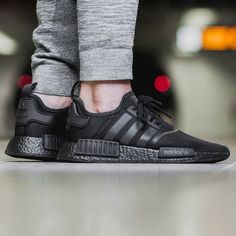 "One of the most sought-after colorways of the adidas NMD yet, the popular silhouette gets the ""Triple Black"" treatment, which even includes the Boost foam midsole. Adidas Nmd R1, Latex Fashion, Fashion Models, Fashion Shoes, Fashion Trends, Fashion Clothes, Fashion Inspiration, Sport Outfits, Summer Outfits"