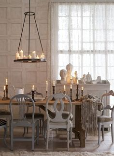 Love everything--all the varied candles, the candles in the chandy, the vignette in the window...and what a great window...