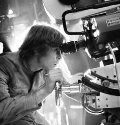 Luke Skywalker behind the lens.  I know most of these pictures are of laughing and stuff, but there are other kinds of joys.  I happen to think looking through the lens of a 35mm Panavision camera would be one of them.