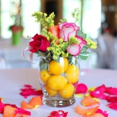 We could add flowers to the lemon centerpieces. Table Arrangements, Floral Arrangements, Flower Arrangement, Lemon Centerpieces, Clear Vases, Party Entertainment, Luau, Event Decor, Party Planning