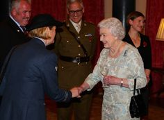 Queen Elizabeth II talks to guests during The Recovery Pathway Reception at Buckingham Palace on November 2014 in London, England. The Duke of Cambridge and Prince Harry hosted the event to. Get premium, high resolution news photos at Getty Images British Prince, British Royals, Royal Throne, Hm The Queen, Prince Harry, Prince Philip, Prince William, Royal Engagement, Queen Mother