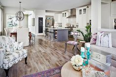 Love the floors with white Cabinets. The black iron chandelier is a perfect contrast
