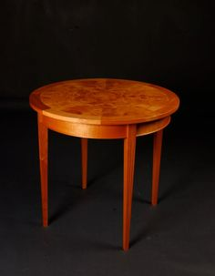Round table designed and built by Salmon Bay Woodworks.