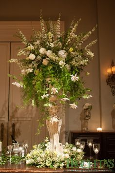 Decorate the stage area with two tall floral arrangements to make the alter symmetrical. Photo by Candi Coffman #trochtas #wedding #flowers #ceremony