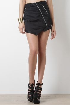 Stay on the stylish path in this Chic Chick Skirt. This trendy skirt features reptile texture fabric, leatherette trimming, diagonal zipper fastener, double faux side zipper, strategically place seam, and under lining