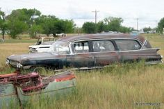 Field of rusted cars in rural Colorado