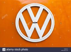 Horizontal close up of white VW T2 camper van logo on orange bonnet Stock Photo