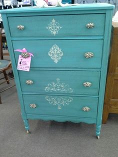 SOLD - This four drawer chest has been painted , stenciled , distressed and finished with a dark wax. It has the original pulls as well as the wheels. The dresser measures 29 inches across the front, 18 inches deep and it stands 44 inches tall. It can be seen in booth A8 at Main Street Antique Mall 7260 East Main St ( E of Power Rd ) Mesa 85207  480 9241122open 7 days 10 till 530 Cash or charge 30 day layaway also available